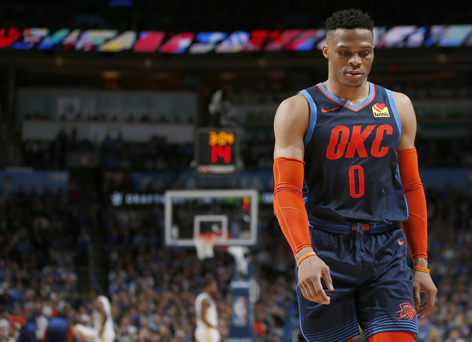Photo - Oklahoma City's Russell Westbrook (0) walks off the court during the NBA basketball game between the Oklahoma City Thunder and the Golden State Warriors at Chesapeake Energy Arena,  Saturday, March 16, 2019. Photo by Sarah Phipps, The Oklahoman
