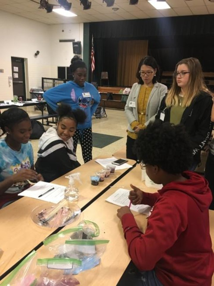 Photo -  Students discuss what they learned as part of a STARBASE Oklahoma/Greater Oklahoma chapter of the Women's Energy Network class. The two are working together to get diverse youths interested in careers involving science, technology, engineering and math.