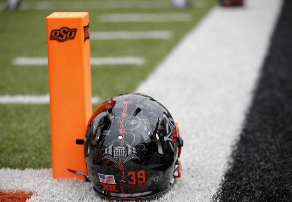 Photo -  The payroll cutbacks impacted 232 of the department's 241 employees, but assistant football coaches under contract did not have their salaries affected, according to a document obtained from OSU by the USA Today Network and The Oklahoman. [Sarah Phipps/The Oklahoman]