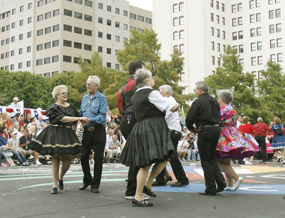 Photo - The Central District Square Dance Association performs during the Oklahoma Centennial Parade in downtown Oklahoma City, Okla., Sunday, October 14, 2007. Photo by Paul Hellstern / The Oklahoman.