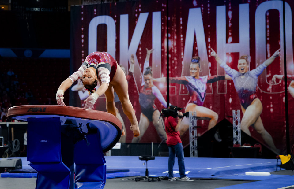 Photo - University of Oklahoma's Maggie Nichols competes in the vault during the women's gymnastics competition between the University of Oklahoma and Arkansas at the Lloyd Noble Center in Norman, Okla Monday, Jan. 20, 2020. Nichols scored a perfect 10 on the vault.   [Chris Landsberger/The Oklahoman]