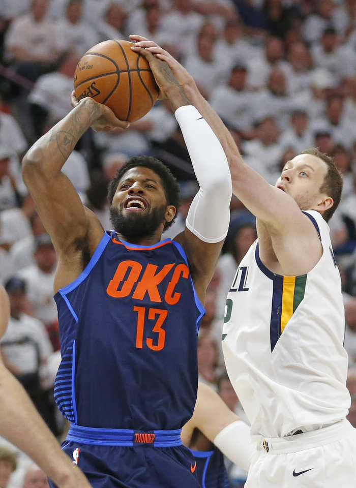 Photo - Utah Jazz forward Joe Ingles, right, blocks the shot of Oklahoma City Thunder forward Paul George (13) in the first half during Game 4 of an NBA basketball first-round playoff series Monday, April 23, 2018, in Salt Lake City. (AP Photo/Rick Bowmer)