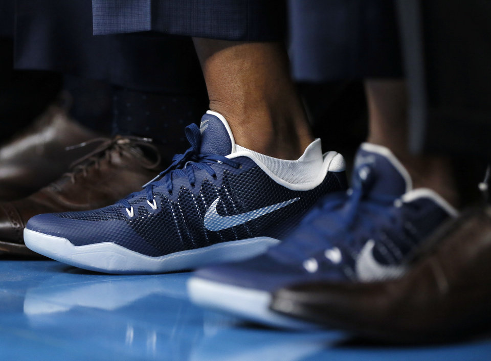 Photo - Oklahoma City assistant coach Maurice Cheeks wears a pair of Kobe Bryant shoes during an NBA basketball game between the Oklahoma City Thunder and Dallas Mavericks at Chesapeake Energy Arena in Oklahoma City, Monday, Jan. 27, 2020. [Nate Billings/The Oklahoman]