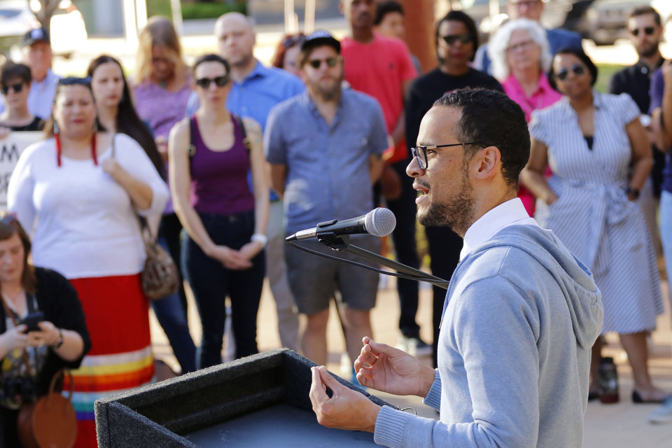 Photo - James Cooper addresses the crowd in front of City Hall. Marchers join councilman-elect James Cooper in a march from Main and Broadway to City Hall in support of the LGBTQ community, Monday, April 8, 2019.  Photo by Doug Hoke/The Oklahoman