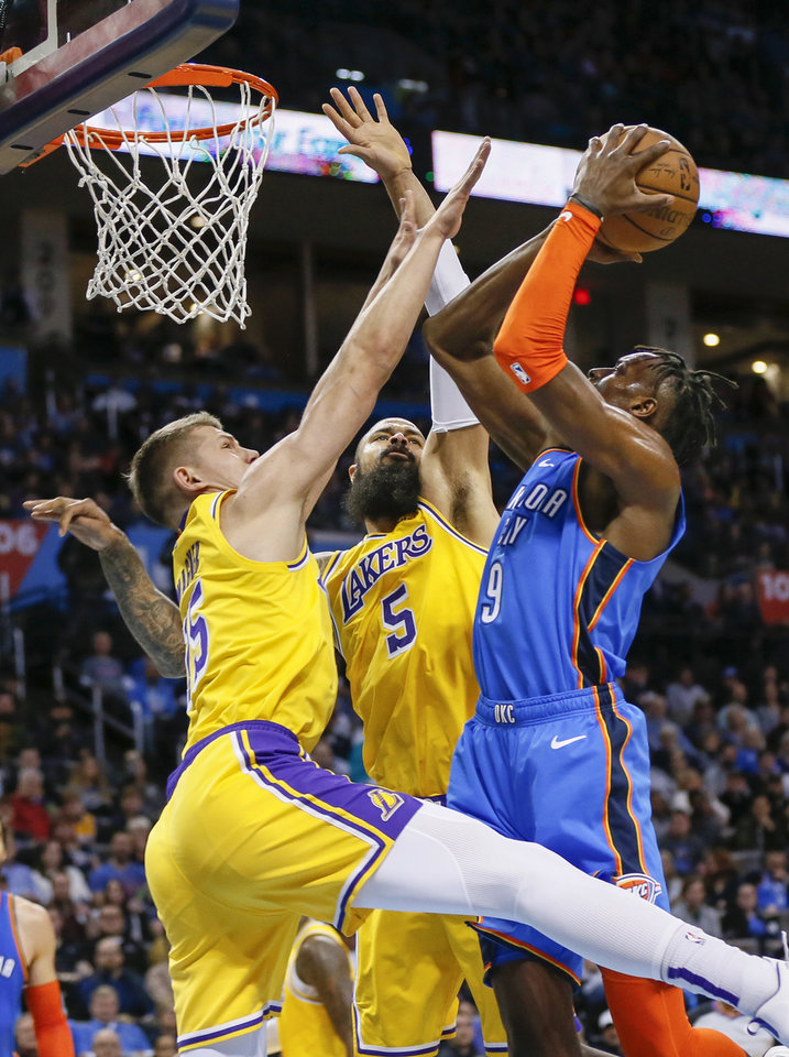 Photo - Oklahoma City's Jerami Grant (9) tries to get a shot past Los Angeles' Tyson Chandler (5) and Moritz Wagner (15) during an NBA basketball game between the Los Angeles Lakers and the Oklahoma City Thunder at Chesapeake Energy Arena in Oklahoma City, Thursday, Jan. 17, 2019. Photo by Nate Billings, The Oklahoman