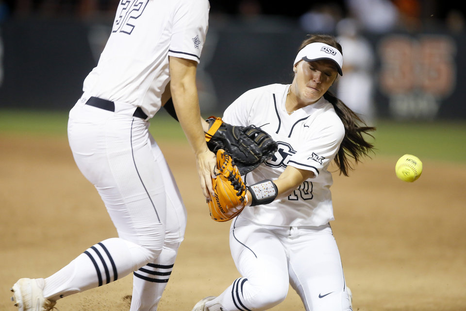 Photo - Oklahoma State's Madi Sue Montgomery (10) collides with Michaela Richbourg (32) as she goes for the ball in the sixth inning of the Stillwater Regional NCAA softball tournament game between Oklahoma State (OSU) and BYU in Stillwater, Okla., Thursday, May 16, 2019. Oklahoma State won 3-1. [Bryan Terry/The Oklahoman]