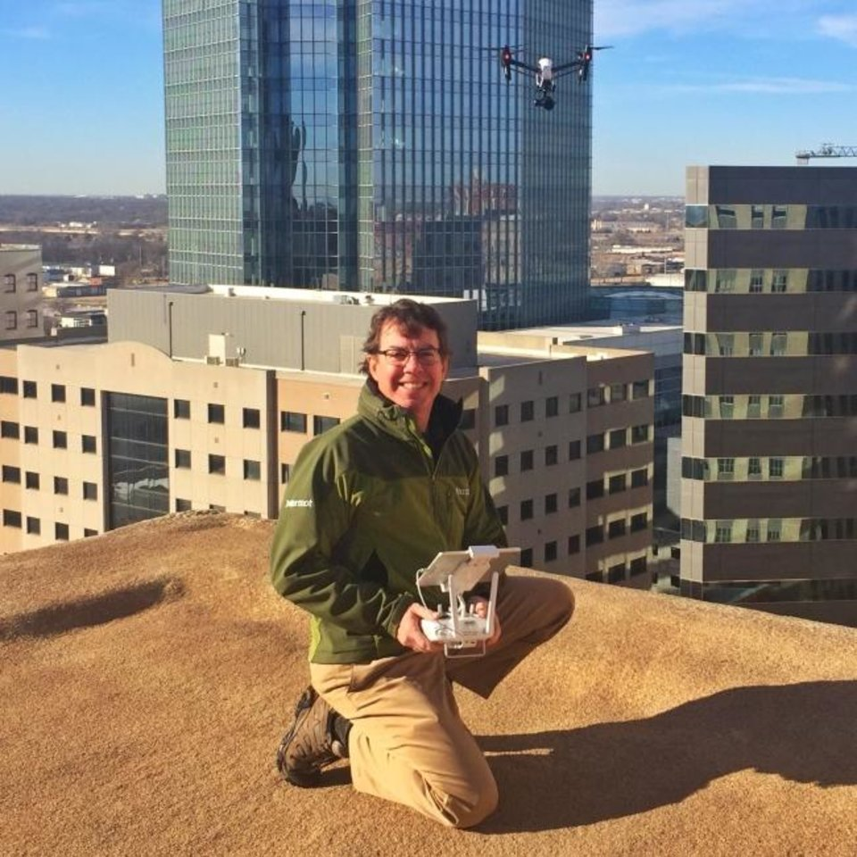 Photo -  Tom Kilpatrick poses with his drone atop the First National Center. [PHOTO PROVIDED]