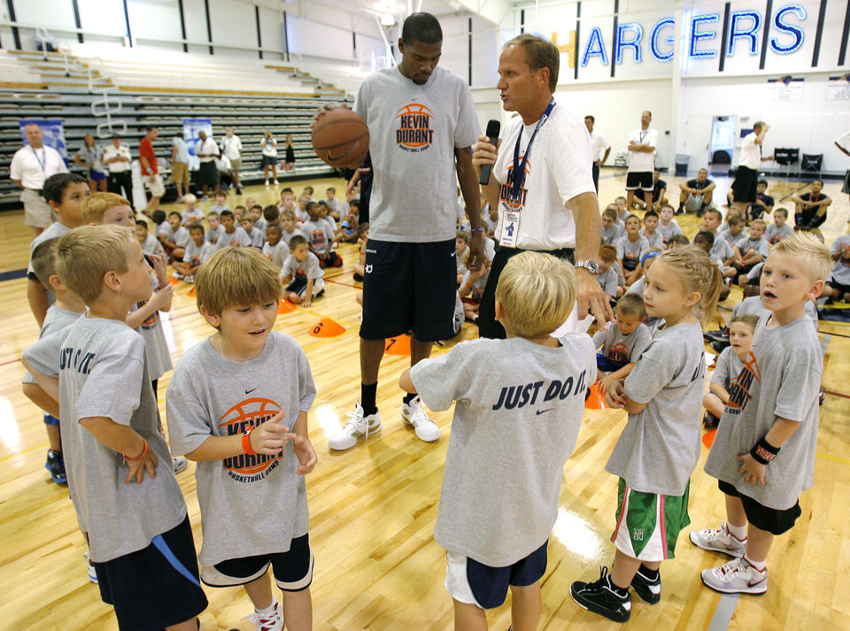 Photo - Kevin Durant gets ready to do a shootout with camp participants during the second day of the Kevin Durant basketball camp at Heritage Hall in Oklahoma City, Thursday, June 30, 2011.  Photo by Garett Fisbeck, The Oklahoman