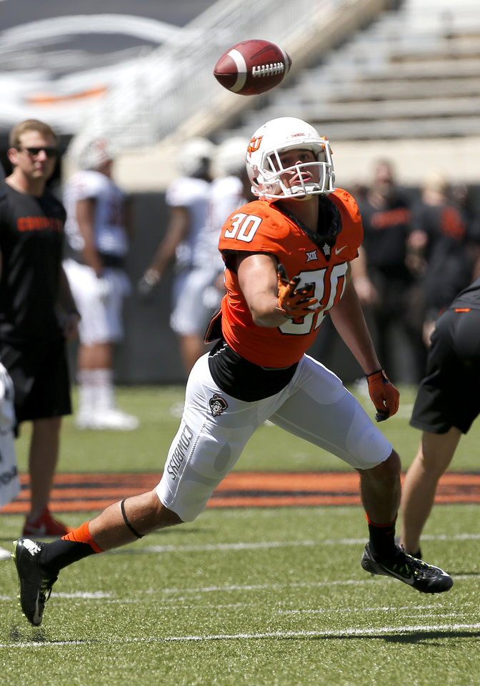 Photo - Oklahoma State's Gabe Simpson (30) looks to make a catch during drills during the Oklahoma State Cowboys spring practice at Boone Pickens Stadium in Stillwater, Okla., Saturday, April 20, 2019.  Photo by Sarah Phipps, The Oklahoman