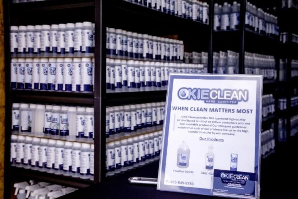 Photo -  Okie Clean hand sanitizer and all purpose cleaner products are shelved at the Okie Clean warehouse. [Chris Landsberger/The Oklahoman]