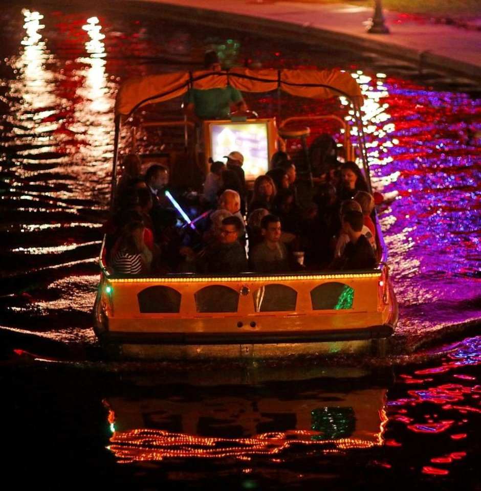 Photo - People take advantage of the first night for Free Holiday Water Taxi rides to see the Bricktown Canal Lights as part of Downtown in December, Friday, November 24, 2017. [Doug Hoke/The Oklahoman Archives]