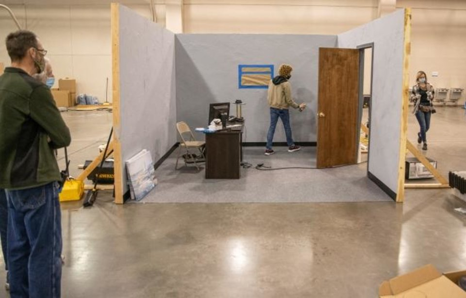 Photo -  Sean Lynch, professor at OCCC and president of the Film Education Institute of Oklahoma, works with students in the art department building a film set at Prairie Surf Studio. [PROVIDED]