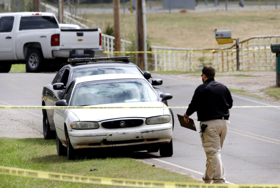 Photo - Scene where a Tecumseh police officer was shot performing a traffic stop overnight. He died from his wounds later this morning at a hospital in Oklahoma City.  Photo by Jim Beckel, The Oklahoman
