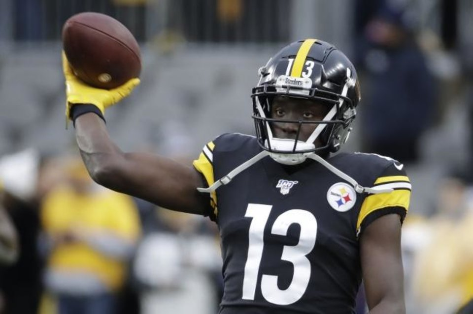 Photo -  Pittsburgh Steelers wide receiver and former Oklahoma State star James Washington warms up before Sunday's game against Clevleand. Washington would lead all Steeler receivers with four catches for 111 yards and a touchdown. [AP Photo/Gene J. Puskar]