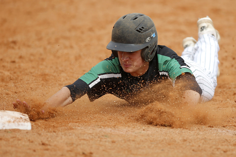 Photo - Braiden Martin of Jones slides back to first during a Class 3A state baseball game against Kingston at Edmond Memorial in Edmond, Okla., Thursday, May 9, 2019. [Bryan Terry/The Oklahoman]