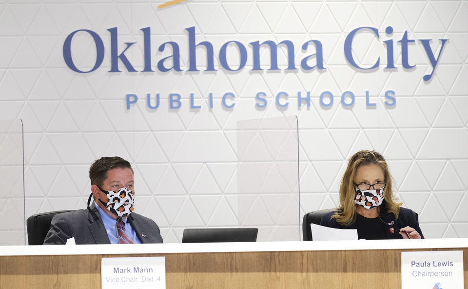 Photo - Mark Mann and Paula Lewis at the first live Oklahoma City School Board meeting in the new Clara Luper Center for Educational Services, Monday, November 9, 2020. [Doug Hoke/The Oklahoman]