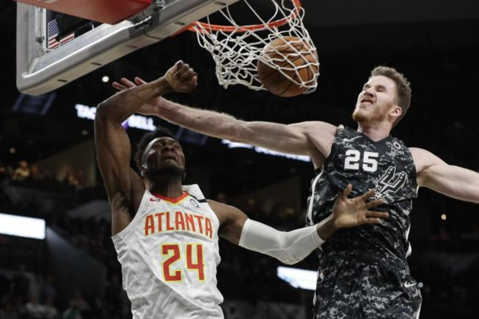 Photo -  Atlanta Hawks forward Bruno Fernando (24) scores past San Antonio Spurs center Jakob Poeltl (25) during Friday night's game in San Antonio. Atlanta won 121-120. [AP Photo/Eric Gay
