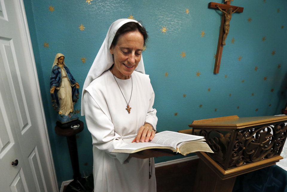 Photo -  Sister Maria Faulkner reads a Bible in the chapel Gospel of Life Dwelling in south Oklahoma City. [Photo by Steve Sisney, The Oklahoman]