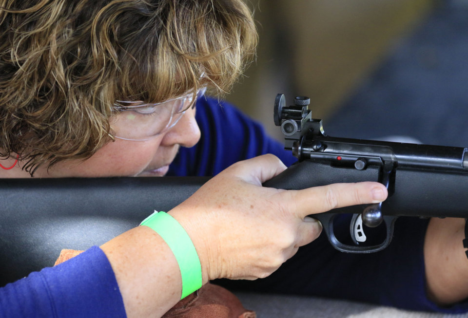 Photo -  Karen Webb shoots a bolt-action .22 rifle during the women's fun shoot on Sept. 10 at the OKC Gun Club. (Photo by Paul Hellstern, The Oklahoman)