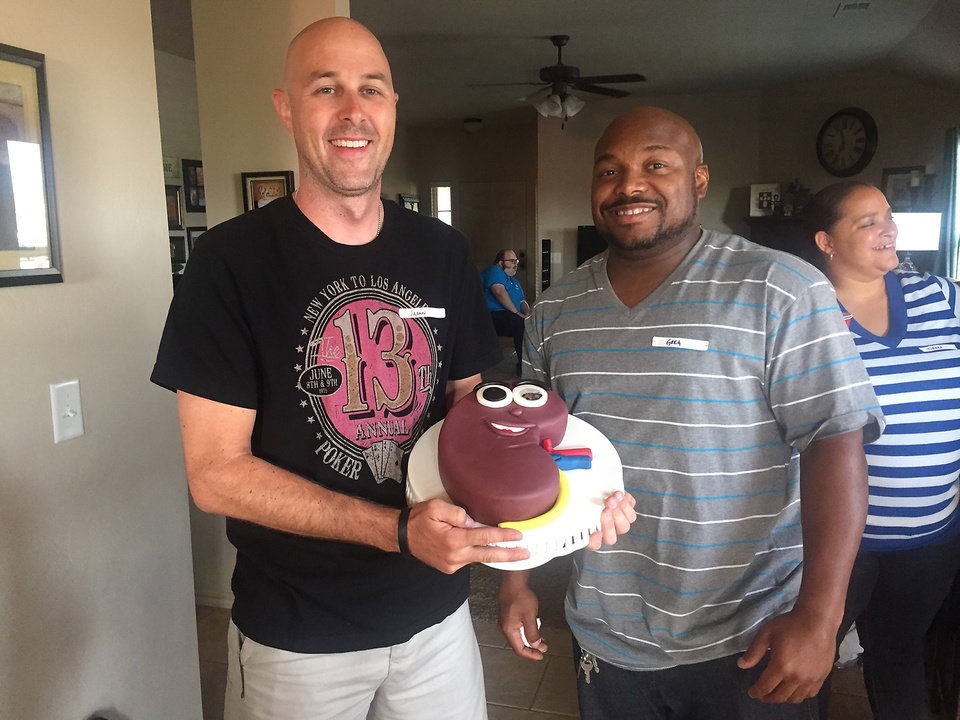 Photo -  Jason Henley, left, and Greg Hall celebrate their birthdays together with a kidney-shaped cake. [PHOTO PROVIDED]
