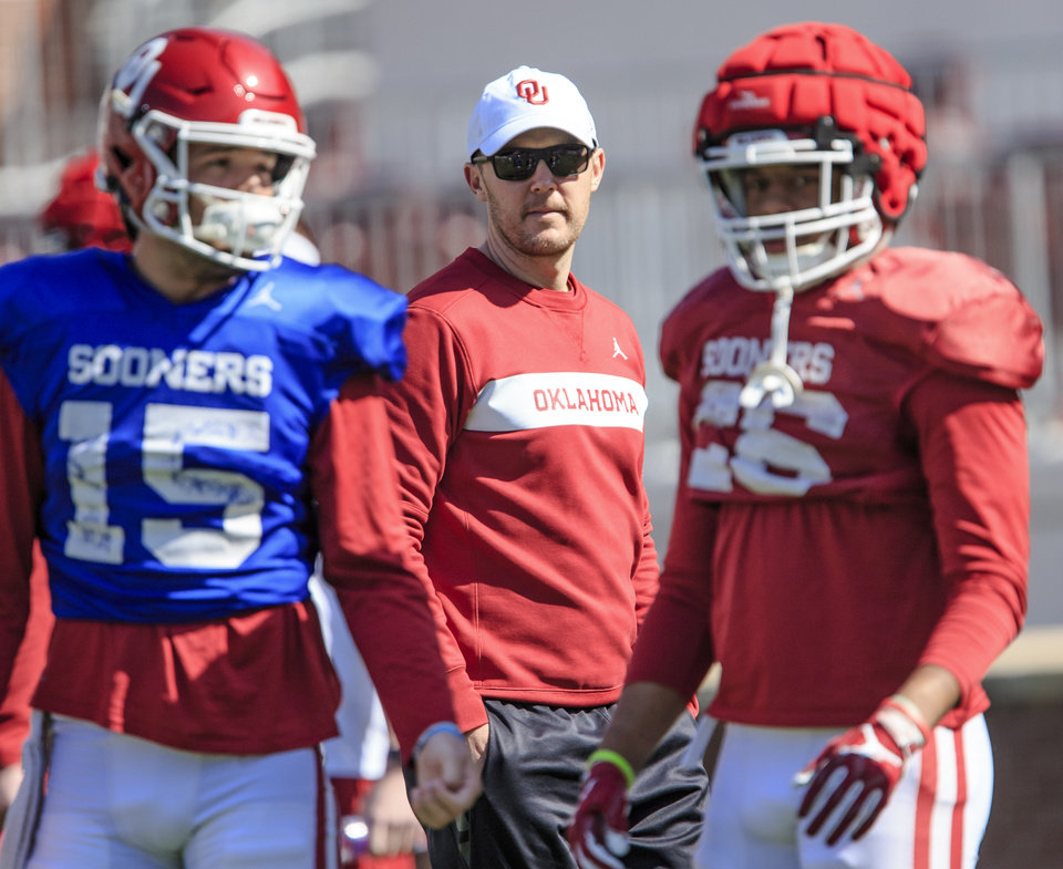 Photo - Head coach Lincoln Riley, center, looks on during the University of Oklahoma spring football practice at the Gaylord Family Oklahoma Memorial Stadium in Norman, Okla. on Monday, April 1, 2019.  Photo by Chris Landsberger, The Oklahoman