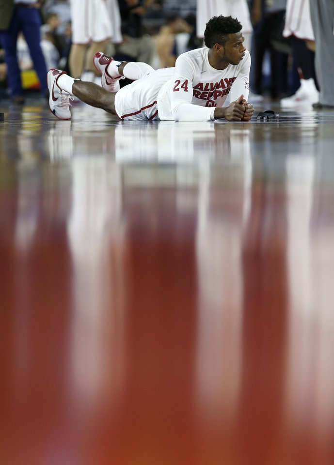 Photo - Oklahoma's Buddy Hield stretches before the national semifinal between the Oklahoma Sooners (OU) and the Villanova Wildcats in the Final Four of the NCAA Men's Basketball Championship at NRG Stadium in Houston, Saturday, April 2, 2016. Photo by Nate Billings, The Oklahoman