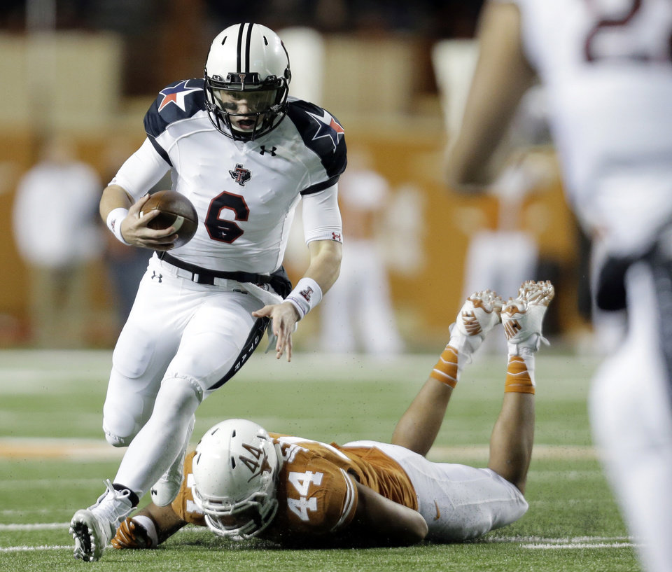 Photo - Texas Tech's Baker Mayfield (6) runs past Texas defender Jackson Jeffcoat (44) during the first half of an NCAA college football game Thursday, Nov. 28, 2013, in Austin, Texas. (AP Photo/Eric Gay)