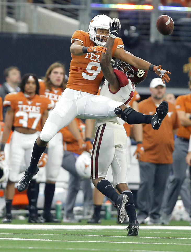 Photo - Oklahoma's Parnell Motley (11) is called for pass interference as he defends Collin Johnson (9) of Texas during the Big 12 Championship football game between the Oklahoma Sooners (OU) and the Texas Longhorns (UT) at AT&T Stadium in Arlington, Texas, Saturday, Dec. 1, 2018.  Oklahoma won 39-27. Photo by Bryan Terry, The Oklahoman