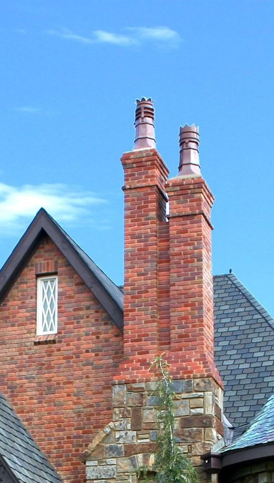 Double Chimneys Tower Over The Roof Line Of A Home Designed By Brent Gibson  That He