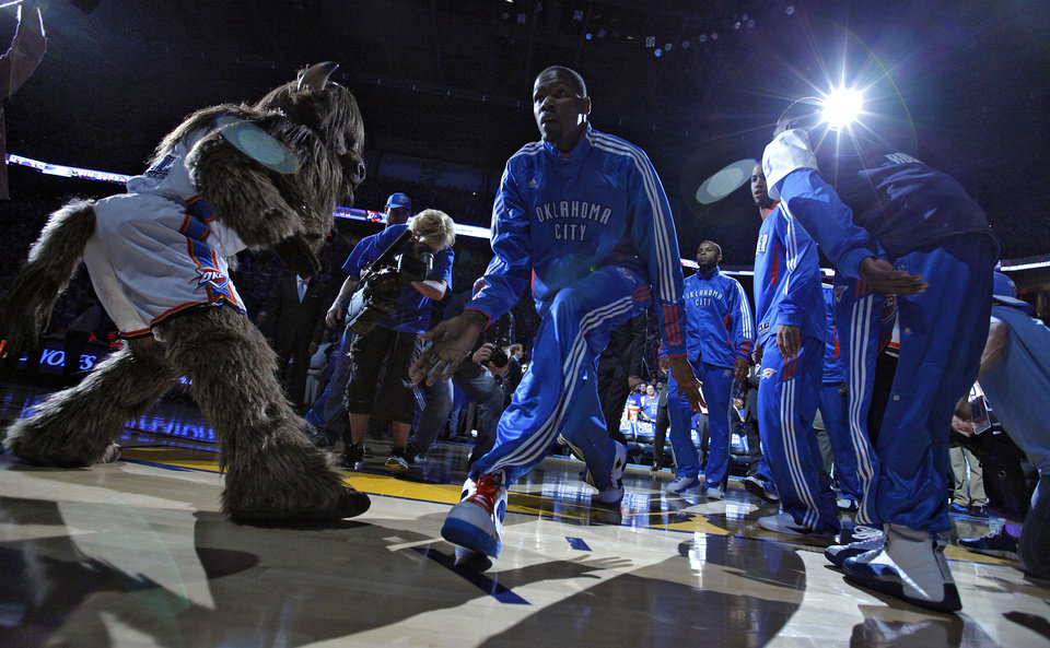Photo - Oklahoma City's Kevin Durant (35) goes through team introductions during the first round NBA basketball playoff game between the Oklahoma City Thunder and the Denver Nuggets on Sunday, April 17, 2011, in Oklahoma City, Okla. Photo by Chris Landsberger, The Oklahoman
