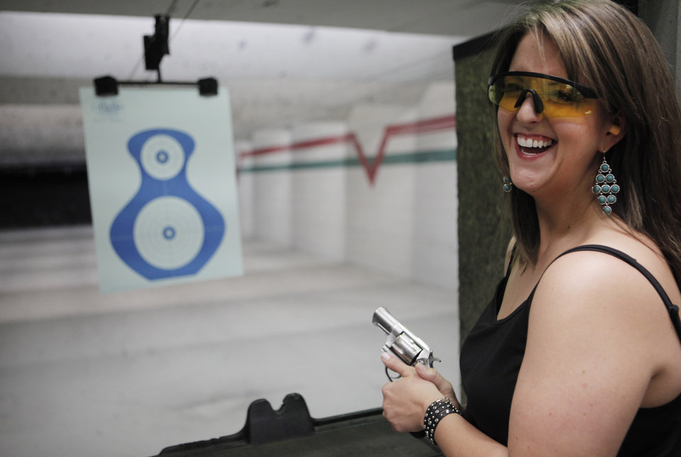 Photo - Lisa Looper, owner of Flashbang Holsters poses for a photo at H&H Shooting Sports gun range on Friday. Flashbang Holsters is a subsidiary of Looper Leather and sells holsters designed for use alongside women's clothing. Photo by KT King, The Oklahoman