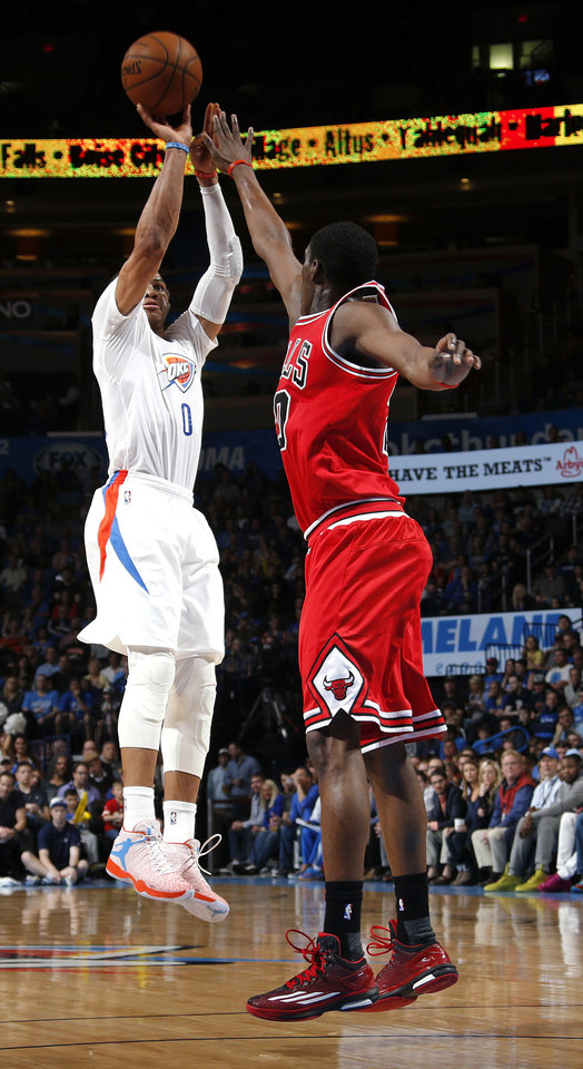 Photo - Oklahoma City's Russell Westbrook (0) shoots over Chicago's Aaron Brooks (0) during the NBA game between the Oklahoma City Thunder and the Chicago Bulls at Chesapeake Energy Arena in Oklahoma City, Sunday, March  15, 2015. Photo by Sarah Phipps, The Oklahoman
