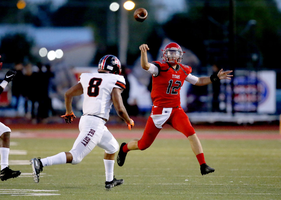 Photo - Carl Albert's Ben Harris throws a pass as he is pressured by Del City's Rejhan Tatum during the high school football game between Carl Albert and Del City at Carl Albert High School in Midwest City, Okla., Friday, Sept. 13, 2019. [Sarah Phipps/The Oklahoman]