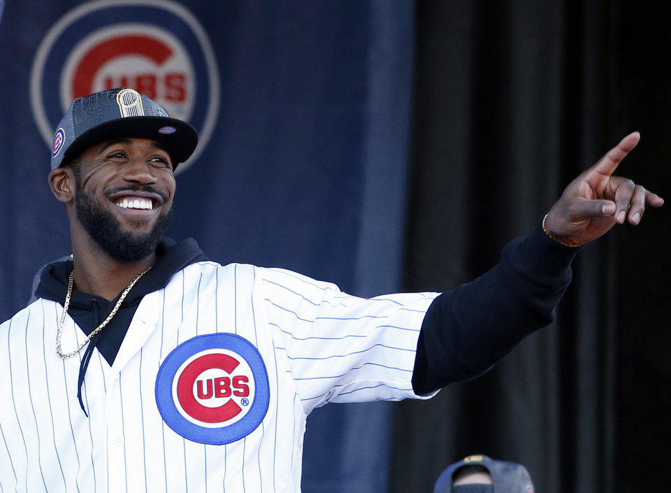 4732722dd Chicago Cubs  Dexter Fowler smiles as he points during a celebration  honoring the World Series