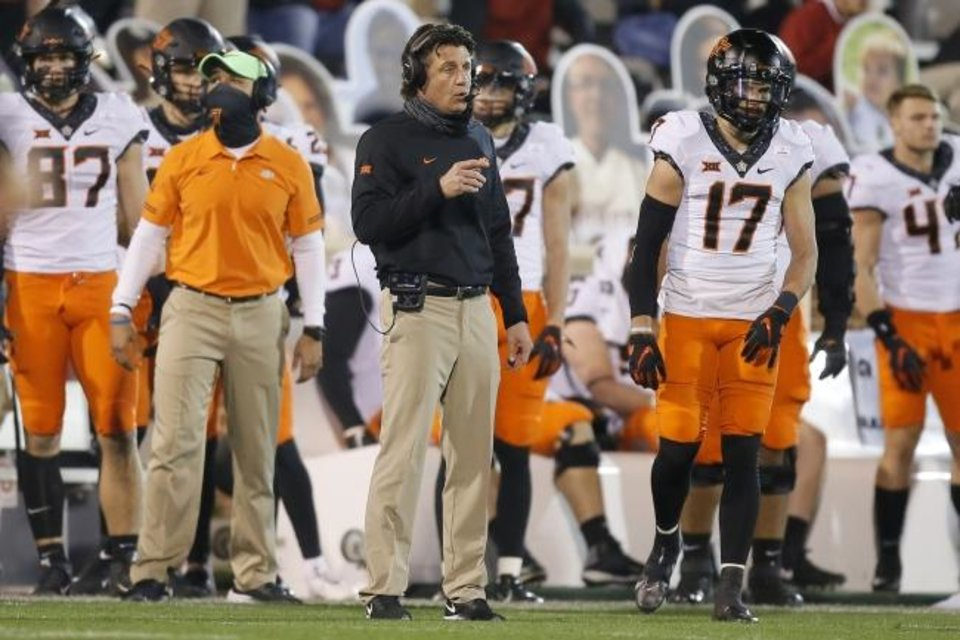 Photo -  Mike Gundy fell to 2-14 against OU as Oklahoma State head coach. [Bryan Terry/The Oklahoman]