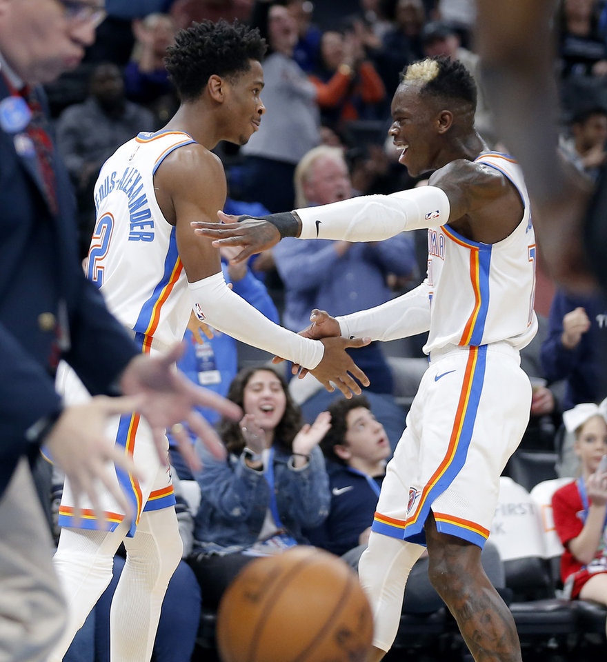 Photo - Oklahoma City's Shai Gilgeous-Alexander (2) and Dennis Schroder (17) celebrate after a basket during an NBA basketball game between the Oklahoma City Thunder and the Memphis Grizzlies at Chesapeake Energy Arena in Oklahoma City, Wednesday, Dec. 18, 2019. Oklahoma City won 126-122. [Bryan Terry/The Oklahoman]