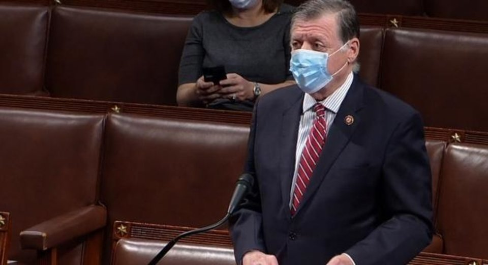 Photo -  U.S. Rep. Tom Cole, R-Moore, speaks Thursday to the House chamber, where many members wore masks as they debated and approved another coronavirus relief bill.