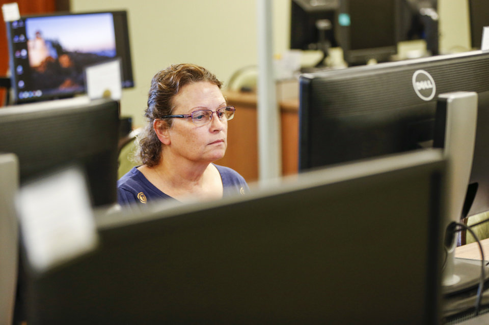 Photo -  Ann Hashman uses a computer at an OK Workforce center in Oklahoma City on Monday.