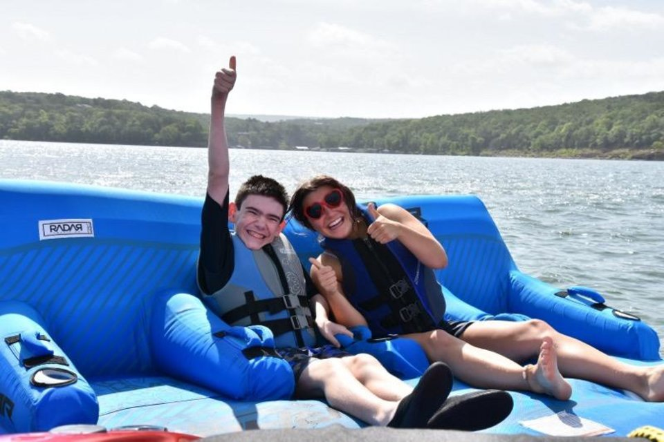 Photo - Past OWL Camp participants enjoy watersports with their sighted buddies. This year's campers will stay at the NewView Oklahoma/Globe Life Lodge at Lake Tenkiller. [NEWVIEW OKLAHOMA]