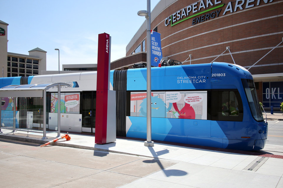 Photo -  A streetcar goes by the Chesapeake Energy Arena platform on Reno.