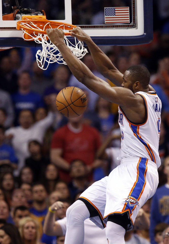 Photo - Oklahoma City's Serge Ibaka (9) dunks the ball in overtime during an NBA basketball game between the Oklahoma City Thunder and the Golden State Warriors at Chesapeake Energy Arena in Oklahoma City, Saturday, Feb. 27, 2016. Golden State won 121-118 in overtime. Photo by Nate Billings, The Oklahoman