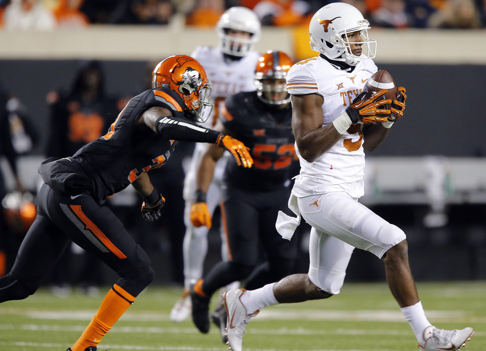 Photo - Texas' John Harris (9) makes a catch in front of Oklahoma State's Tre Flowers (31) during the college football game between the Oklahoma State University Cowboys (OSU) the University of Texas Longhorns (UT) at Boone Pickens Staduim in Stillwater, Okla. on Saturday, Nov. 15, 2014.  Photo by Chris Landsberger, The Oklahoman