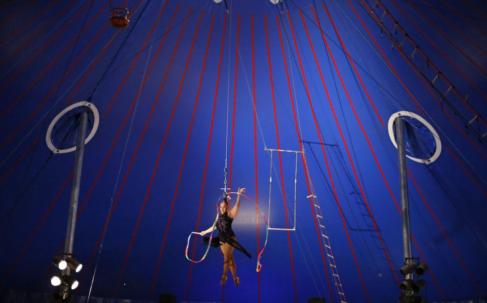 Photo -  Elizabeth Ayala performs with the Zoppe Italian Family Circus on Sept. 24, 2015, at the Oklahoma State Fair. [Photo by Bryan Terry, The Oklahoman Archives]