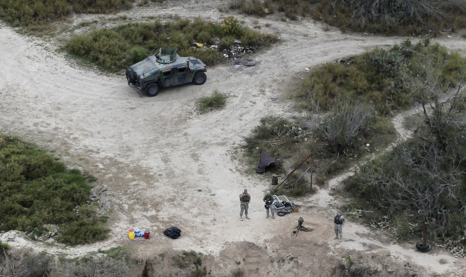 Photo - FILE - In this Feb. 24, 2015, file photo, members of the National Guard patrol along the Rio Grande at the Texas-Mexico border in Rio Grande City, Texas. The Trump administration is considering a proposal to mobilize as many as 100,000 National Guard troops to round up unauthorized immigrants, including millions living nowhere near the Mexico border, according to a draft memo obtained by The Associated Press. (AP Photo/Eric Gay, File)