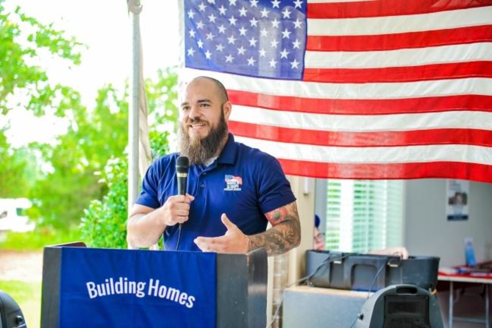 Photo -  U.S. Army Spc. Adam Putt speaks at a ceremony to accept the donation of his home in Blanchard from Homes For Our Troops. [HFOT]