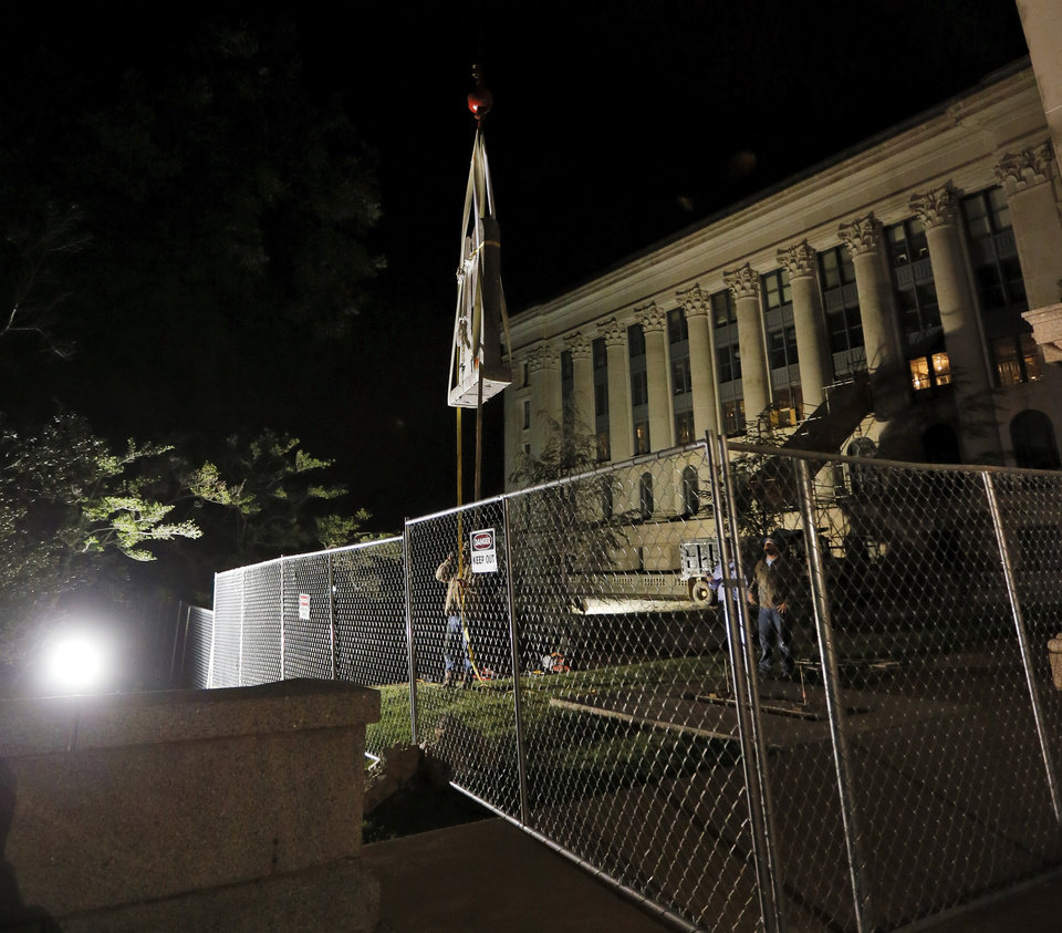 Photo - The Ten Commandments monument is removed from the state Capitol in Oklahoma City, Monday, Oct. 5, 2015. Photo by Nate Billings, The Oklahoman