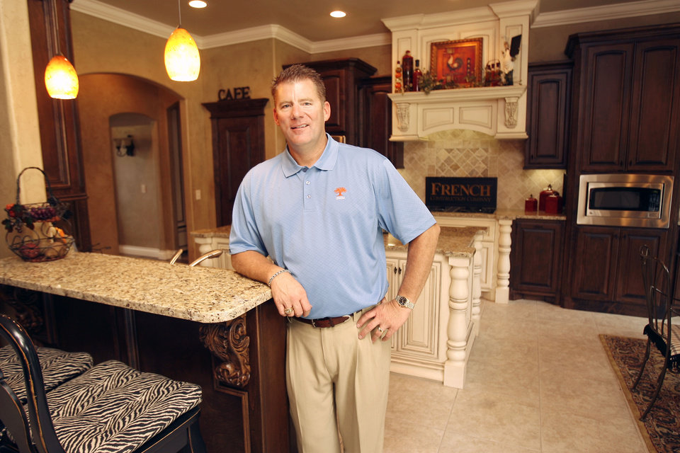 Photo - Builder Tom French shows the kitchen of his model home at 2709 Cattle Drive in the Iron Horse Ranch housing addition in Edmond, OK, Friday, Sept. 18, 2009. By Paul Hellstern, The Oklahoman ORG XMIT: KOD