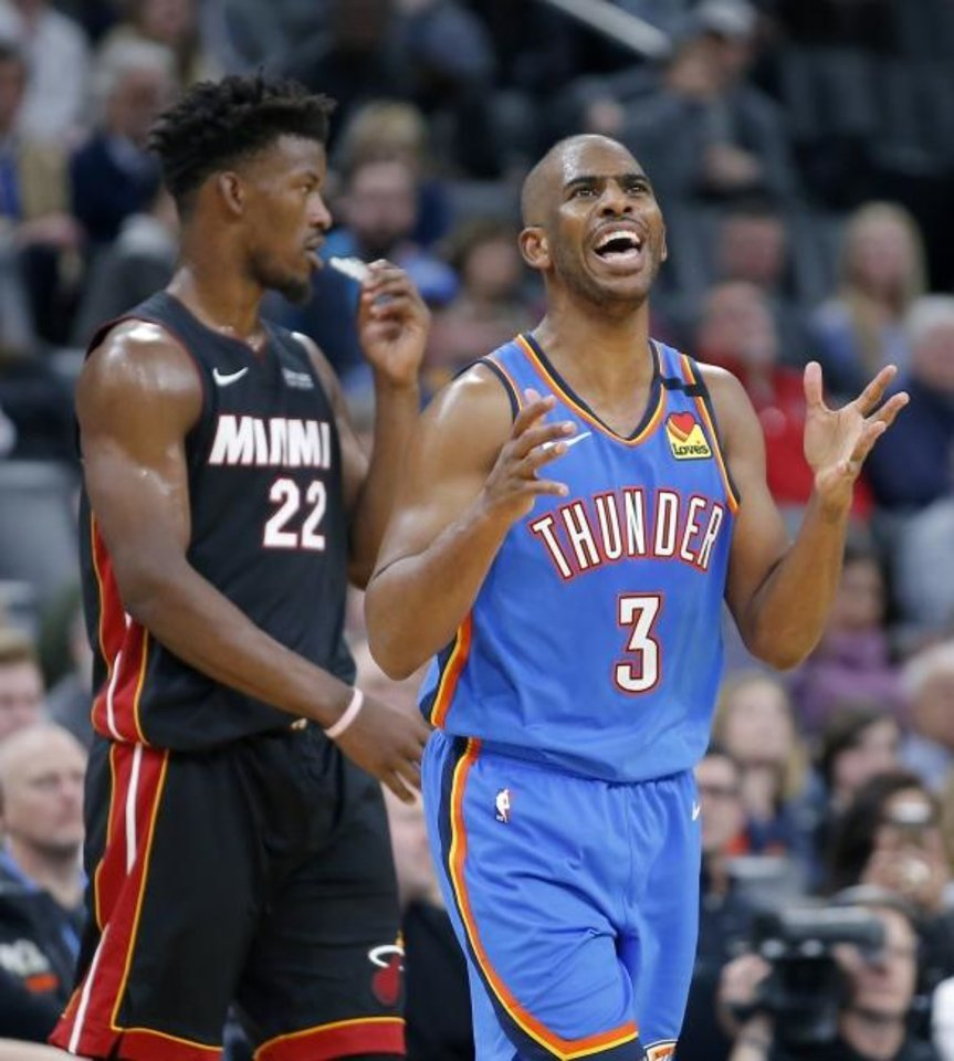 Photo -  Oklahoma City's Chris Paul (3) reacts after fouling Miami's Jimmy Butler (22) during the Thunder's 115-108 loss Friday at Chesapeake Energy Arena. [Bryan Terry/The Oklahoman]