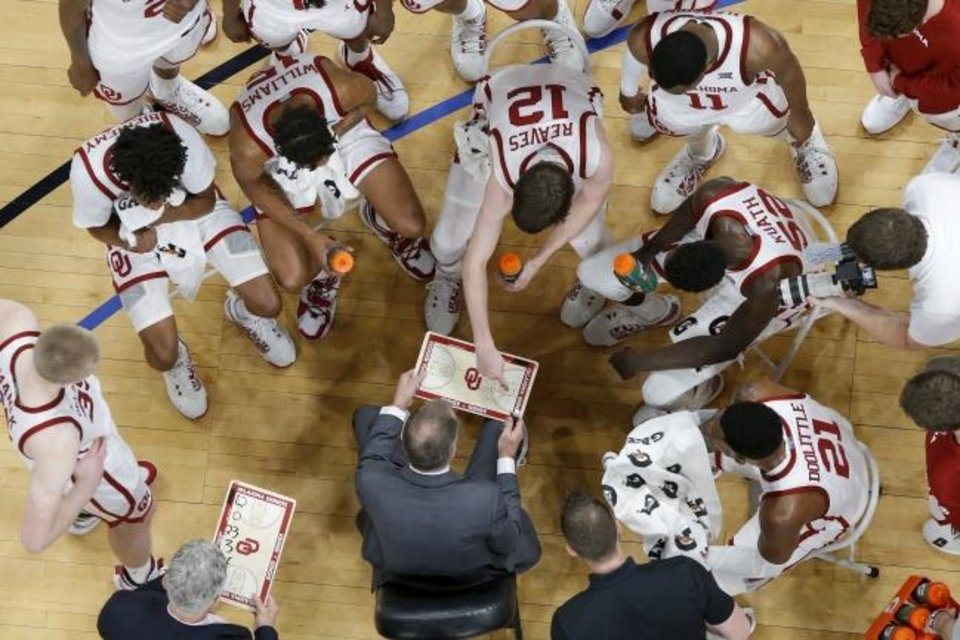 Photo -  OU coach Lon Kruger talks with his team during a timeout during a 63-62 win against Mississippi State on Jan. 25 at Chesapeake Energy Arena. [Bryan Terry/The Oklahoman]