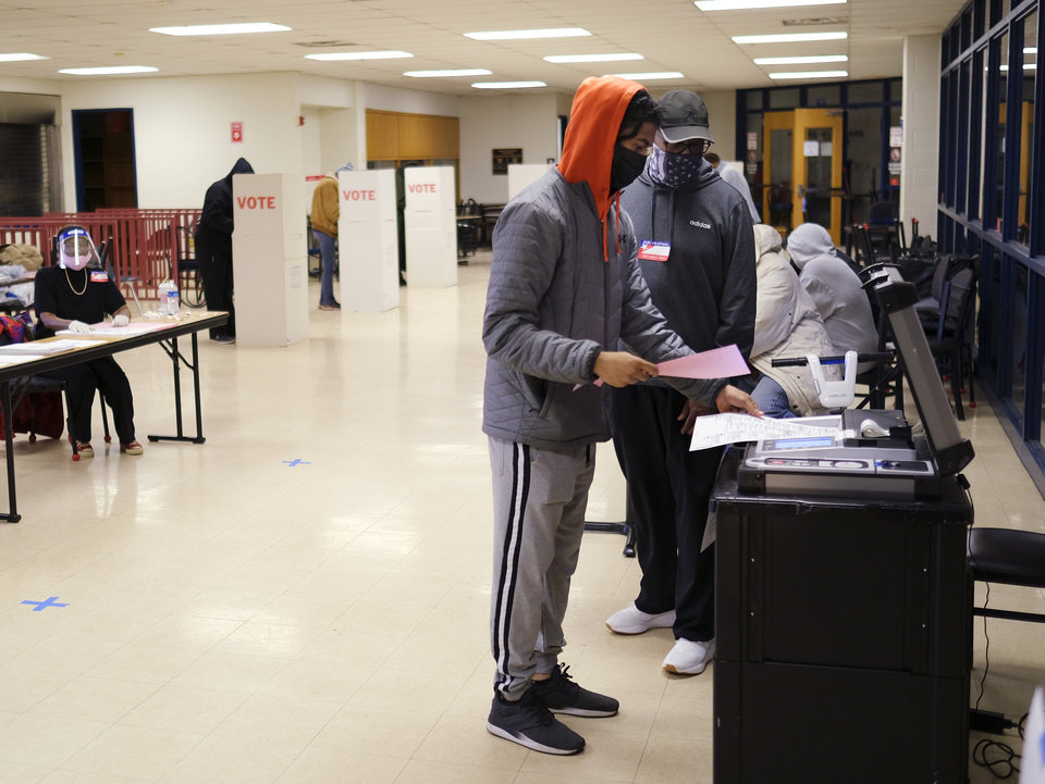 Photo - Election Day voting at Millwood Field House Tuesday, November 3, 2020. [Doug Hoke/The Oklahoman]